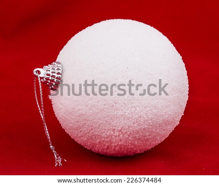 White christmas ball on red background - stock photo