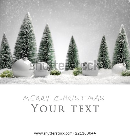 White Christmas balls and fir tree on snow - stock photo