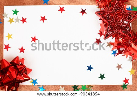 White Christmas card with stars and bows decorations on golden silk background
