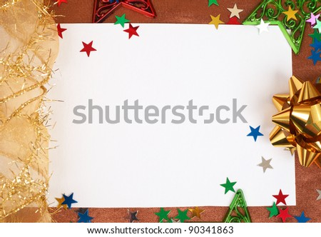 White Christmas card with stars and bows decorations on golden silk background - stock photo