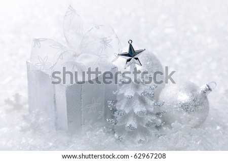 White christmas decoration on white snow background - stock photo