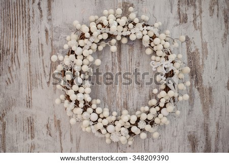 white christmas decorative wreath over the wooden background - stock photo