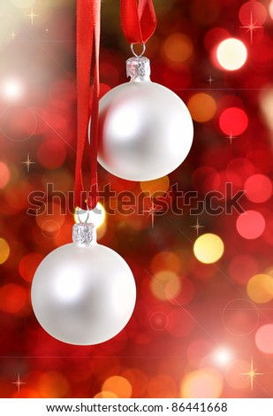 White Christmas tree decorations on lights background