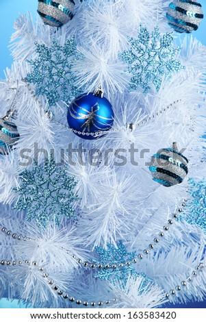 White Christmas tree on blue background - stock photo