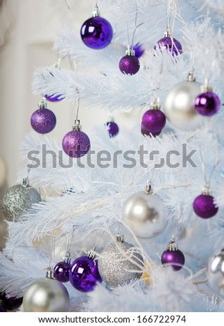 white christmas with purple and silver toys - stock photo