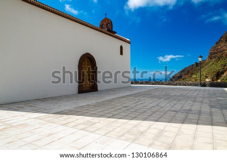 White church canary style architecture blue sky, Valle Gray Rey, La Gomera, Canary Islands - stock photo