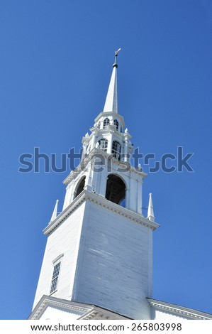 white church steeple with blue sky background - stock photo
