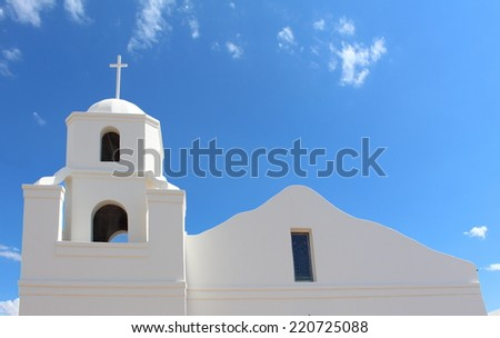 White Church with Cross - Blue Sky with Clouds - stock photo