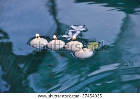 White Circle Candles with Fire on Water