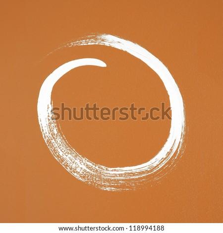 White circle painted on orange background. Brush stroke texture. - stock photo