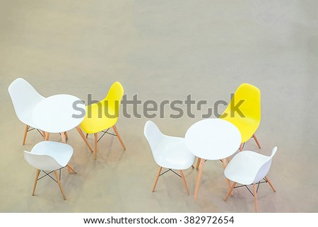 White circle table and chairs on carpet floor. view from above - stock photo