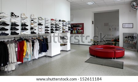 white clean and brand new shoes store - stock photo