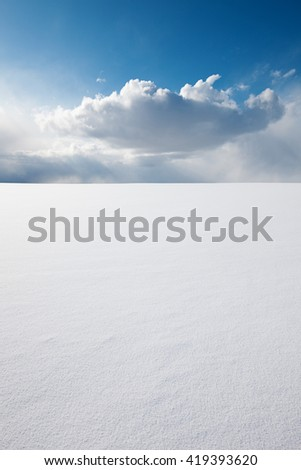 White clear surface of snow till flat horizon and beautiful cloudscape; copy space - stock photo