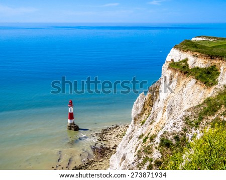 White cliffs and lighthouse. Eastbourne, East Sussex, England (UK) - stock photo