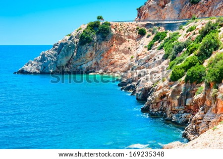 white cliffs stretching into the calm blue sea - stock photo