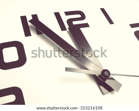 white clock face; vintage filter effect - stock photo