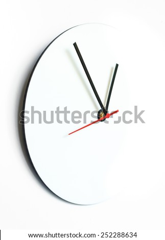 White clock isolated. Abstract clock. Blank clock isolated. Empty clock isolated. Wall clock. White clock on wall. Modern clock isolated. Abstract wall clock. White clock art. Blank white clock. - stock photo
