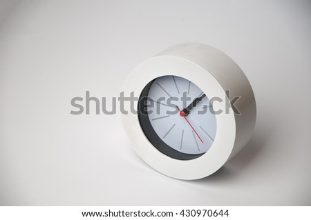 White clock isolated on a white background - stock photo