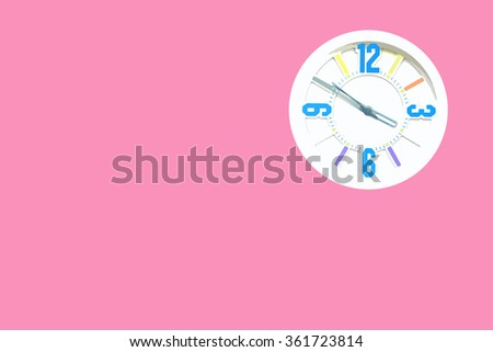 White clock on pink background.