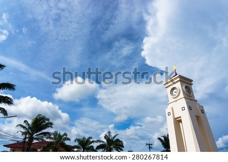 white clock tower under big cloud in the skies