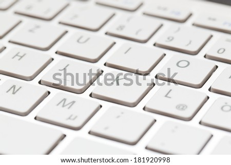 White close up of keyboard of a modern laptop  - stock photo