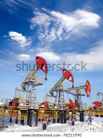 White clouds above oil field. Oil and gas industry - stock photo