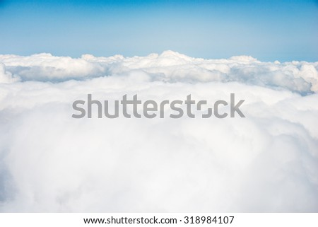 white clouds above the clouds
