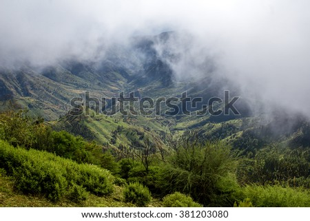 White clouds above the green mountains on La Gomera island in Spain - stock photo