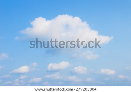 white clouds against blue sky.