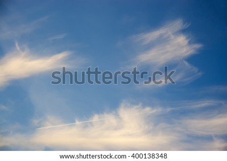 white clouds against the blue sky - stock photo