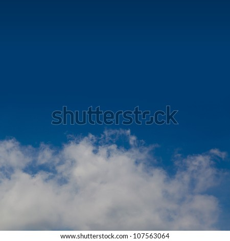 White Clouds Against The Blue Sky Background With Space for Text Isolated on Blue
