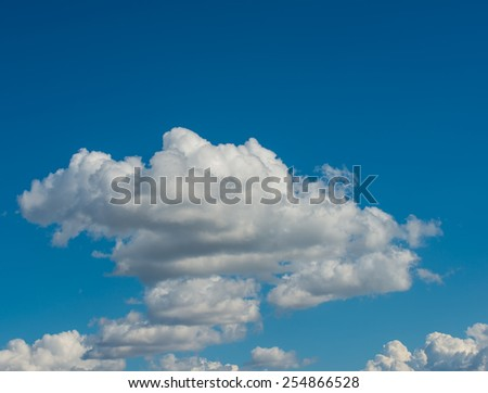 white clouds against the blue sky on a sunny day - stock photo