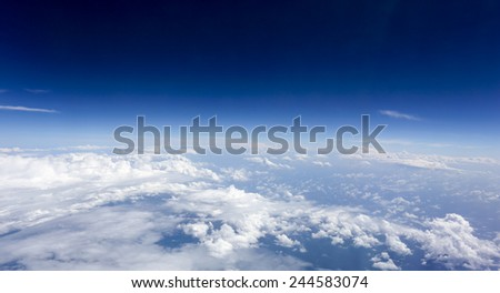 White clouds and blue sky seen from airplane. - stock photo