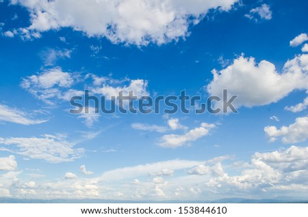 White clouds in blue sky. - stock photo