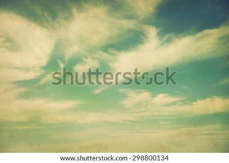 White clouds in blue sky, vintage style - stock photo