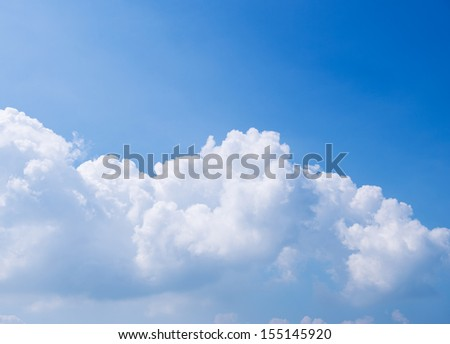 White clouds in the blue sky. - stock photo