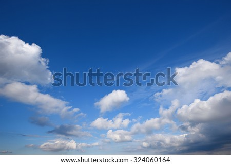 White clouds in the blue sky on a summer day - stock photo