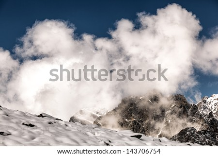 White clouds in the rugged mountains of the Caucasus
