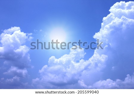 White clouds on a blue sky background.