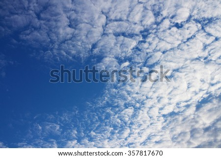White clouds on a blue sky, weird pattern