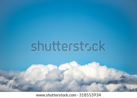 White clouds on the blue sky. Nature background - stock photo