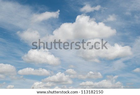 white clouds over deep blue sky background - stock photo