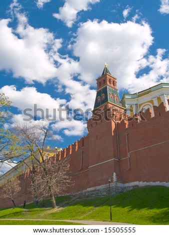 White clouds over red brick wall of Moscow Kremlin