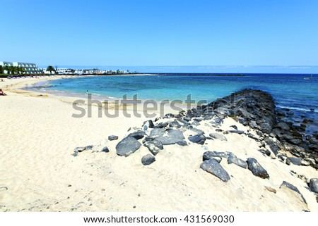 white coast lanzarote  in spain   beach  stone water  and summer  - stock photo