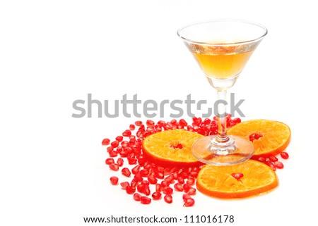 white cocktail pomegranate with orange on isolate background - stock photo