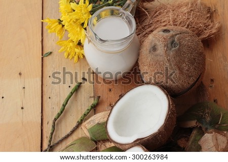 white coconut and milk on wood background