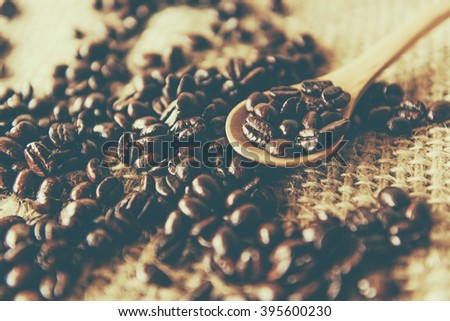 White coffee cup  and coffee beans around