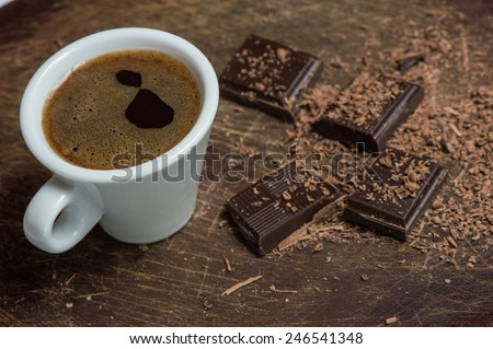 White Coffee cup and dark chocolate - stock photo