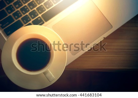 white Coffee cup and laptop for business in cafe - stock photo