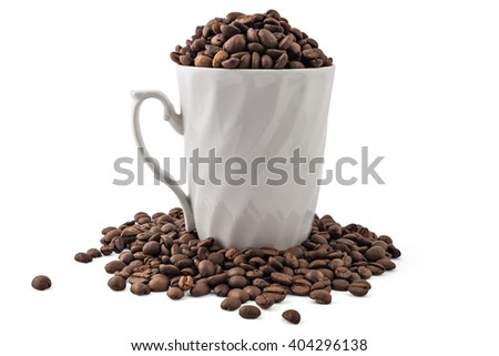 White coffee cup and spilled coffee-beans isolated on white - stock photo